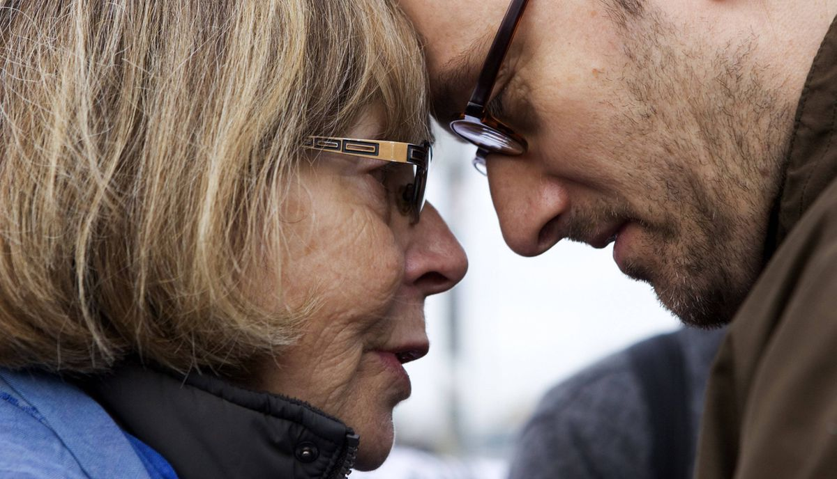 Mother Darlene Burke receives an embrace from Christian Schuck, Jenna's brother-in-law, during a memorial for Jenna Morrison, who was recently killed after being struck by a truck while riding her bike at Sterling and Dundas in Toronto.