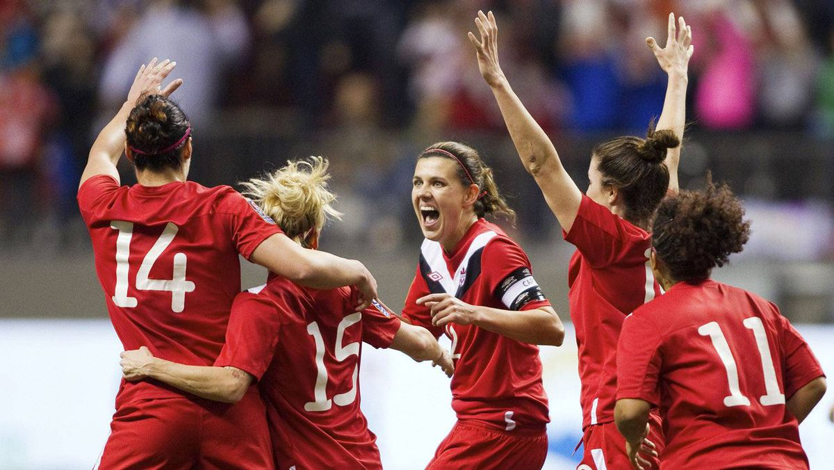 Christine Sinclair (12) of Canada celebrates her goal against Mexico with teammates during the first half of their semi-final CONCACAF Women's Olympic qualifying soccer match in Vancouver, British Columbia January 27, 2012.
