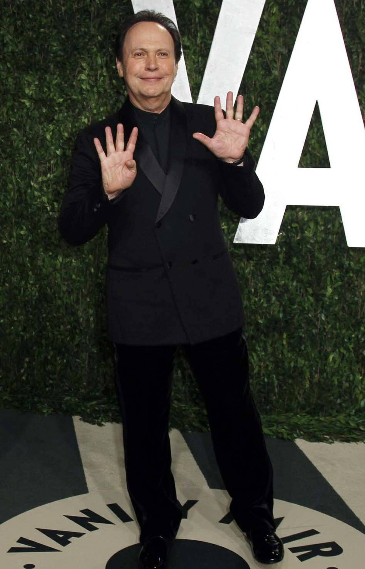 Billy Crystal counts the number of times he's been funny since 1991 at the Vanity Fair Oscar party in West Hollywood on Sunday.