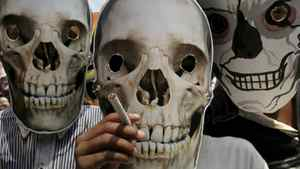 "Indian street children wear human skull masks during a "" World No Tobacco Day"" awareness rally in Kolkata, India, Tuesday, May 31, 2011. According to the World Health Organization, this year, the tobacco epidemic will kill nearly 6 million people, including some 600,000 nonsmokers who will die from exposure to tobacco smoke.( AP Photo/Sucheta Das)"