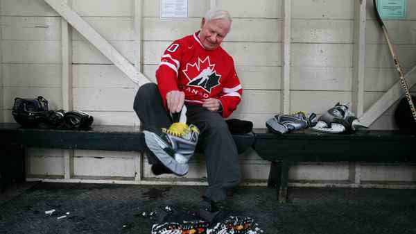 Governor General David Johnston laces up his skates prior to skating at the outdoor rink at Rideau Hall in Ottawa on March 1, 2012.