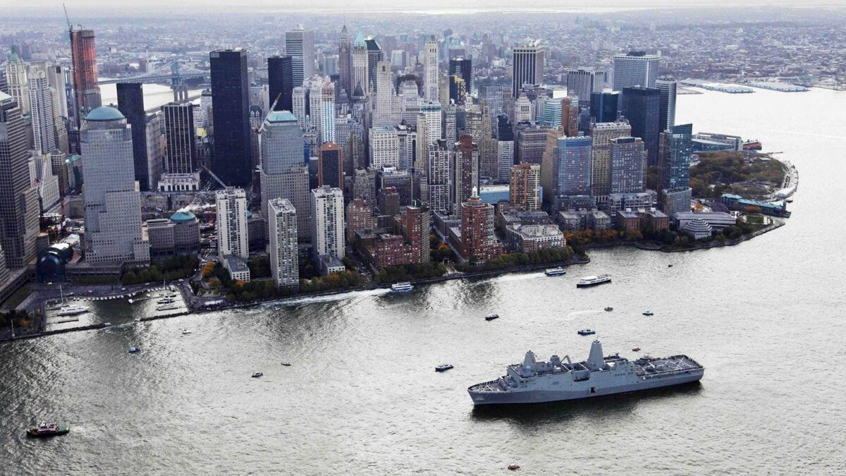 The new Navy assault ship USS New York, built with World Trade Center steel, passes lower Manhattan as it arrives Nov. 2, 2009 in New York.