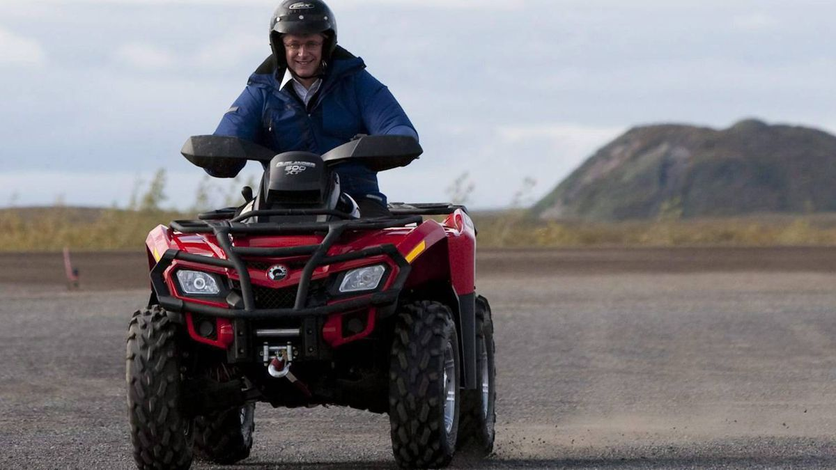 Stephen Harper drives an ATV as he visits Tuktoyaktuk, Northwest Territories on the fourth day of his five day northern tour to Canada's Arctic on Thursday Aug. 26, 2010.
