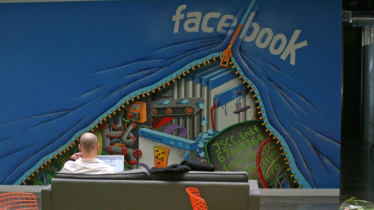 An employee works on a computer at the new headquarters of Facebook in Menlo Park, Calif. in this Jan. 11, 2012 file photo.