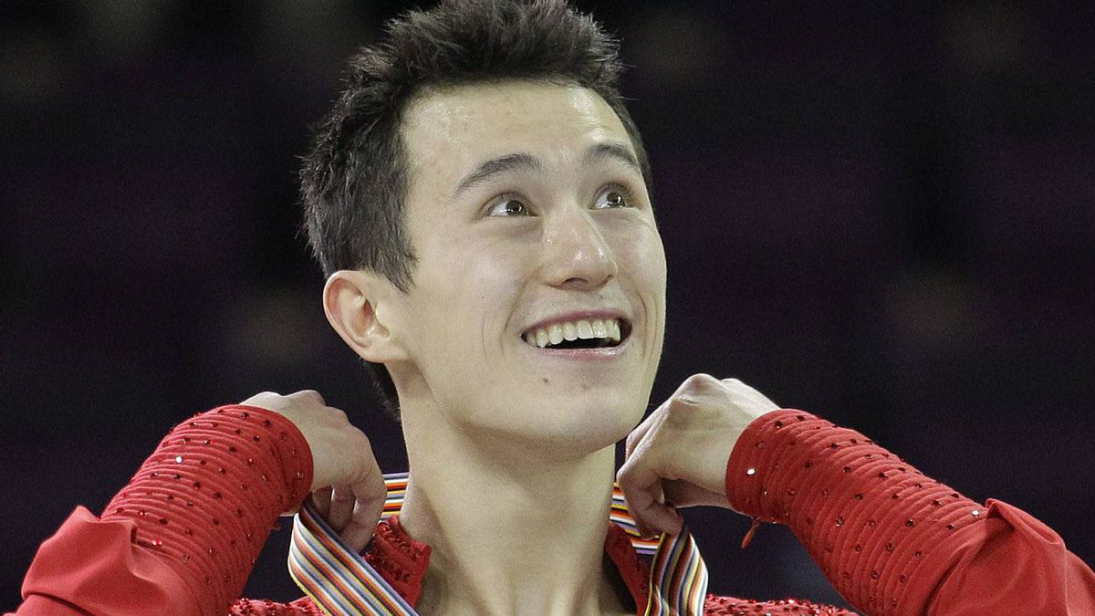 Canada's Patrick Chan wears his gold medal after winning the men's singles skating competition during the Four Continents Figure Skating Championships, Friday, Feb. 10, 2012, in Colorado Springs, Colo. (AP Photo/Julie Jacobson)