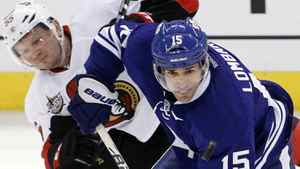 Toronto Maple Leafs' Matthew Lombardi (R) keeps the puck from Ottawa Senators' Sergei Gonchar during the third period of their NHL hockey game in Ottawa February 4, 2012. REUTERS/Blair Gable