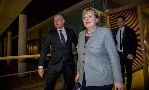 Merkel welcomes SPD's decision to start talks on forming government