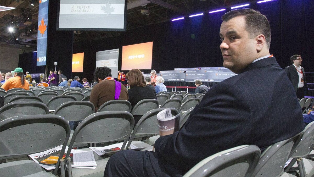 Federal Heritage Minister James Moore of the rival Conservative party attends the NDP leadership convention in Toronto on Saturday, March 24, 2012.