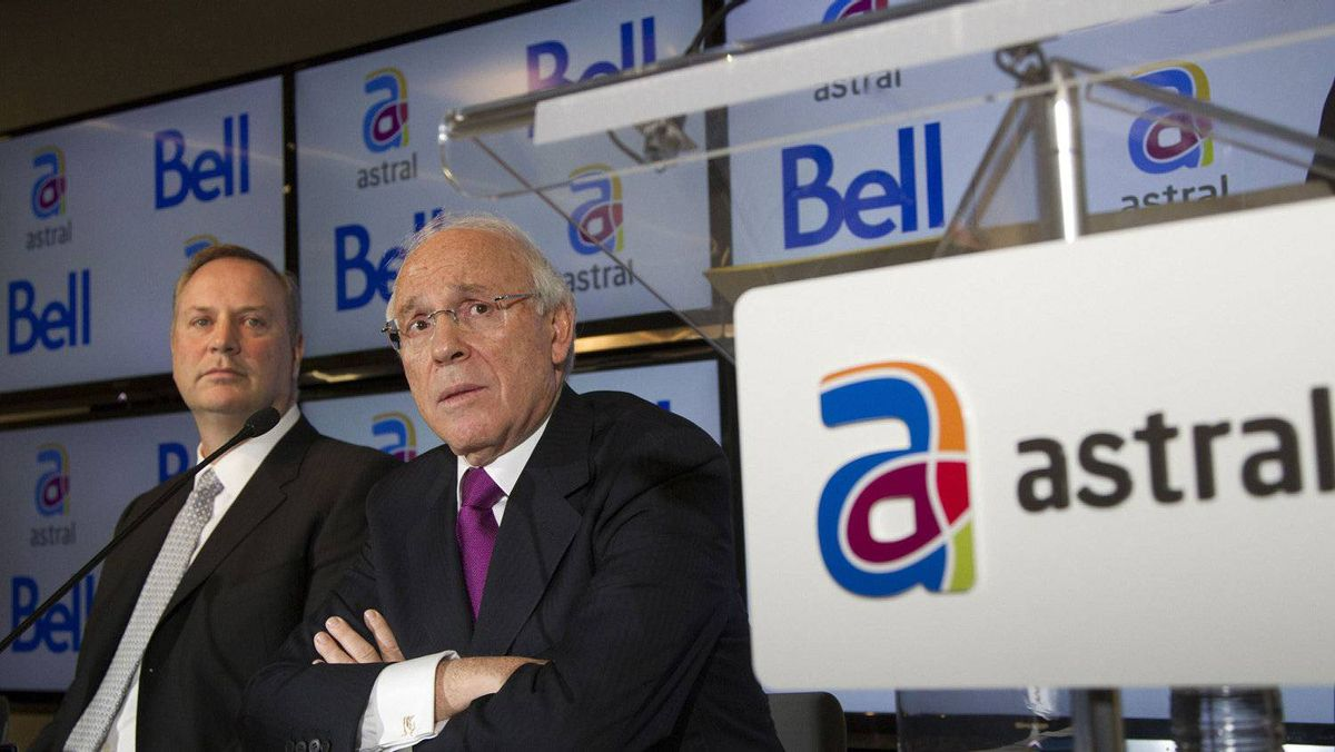 BCE CEO George Cope, left, and Ian Greenberg, CEO of Astral Media Inc., speak at a news conference in Montreal on March 16, after BCE agreed to acquire Astral.