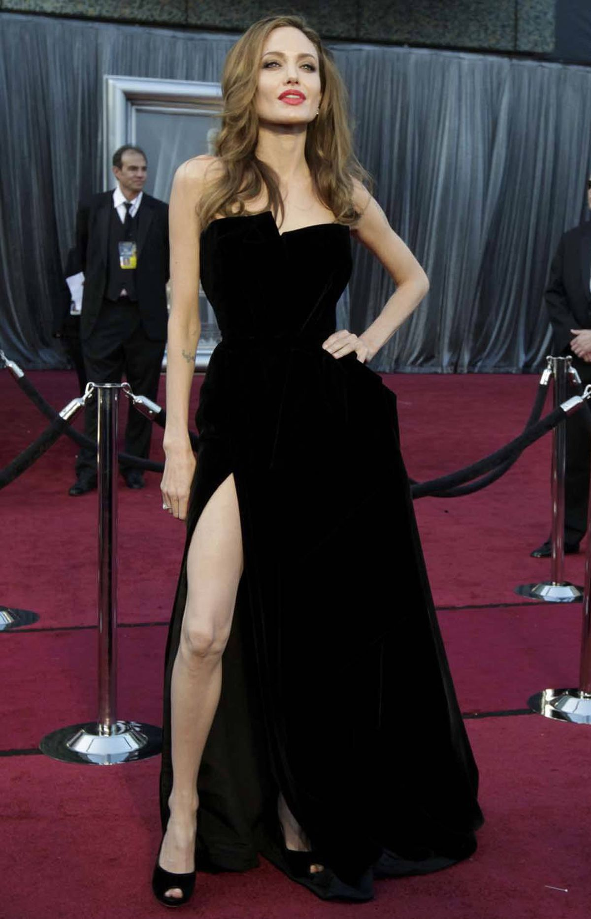 Angelina Jolie wags her now infamous right leg on the Oscars red carpet in Hollywood on Sunday.