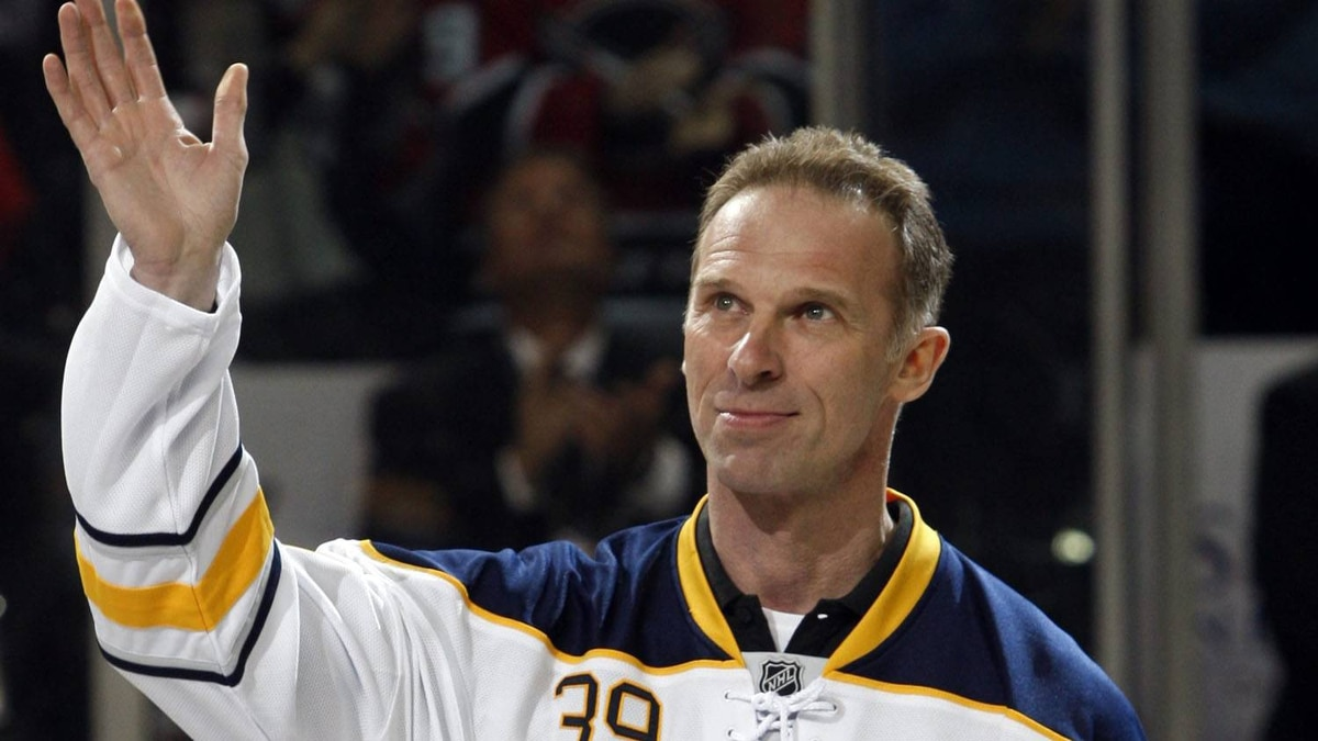 Buffalo Sabres former goalie Dominik Hasek waves to the fans during a pre-game ceremony before an NHL hockey game against the Atlanta Thrashers in Buffalo, N.Y., Saturday, March 19, 2011. (AP Photo/David Duprey)