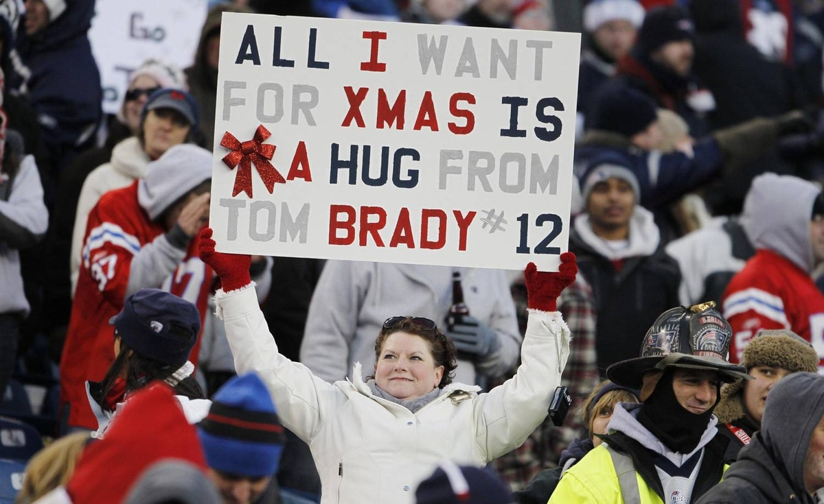 New England Patriots fan holds up a sign in the fourth quarter against the Miami Dolphins at Gillette Stadium. The Patriots defeated the Miami Dolphins 27-24.