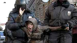 Russian police detain a participant during an opposition rally in St. Petersburg on March 5, 2012.