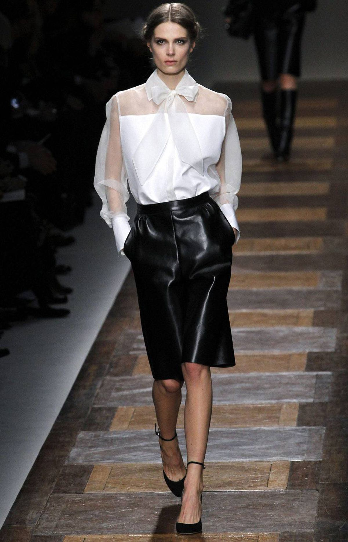 "According to the program notes for the Valentino show, designers Maria Grazia Chiuri and Pierpaolo Piccioli ""indulge in tactile artisan craftsmanship while they reduce a line to its pure architectural essence."" Judging by this outfit, I'd say that's pretty accurate."