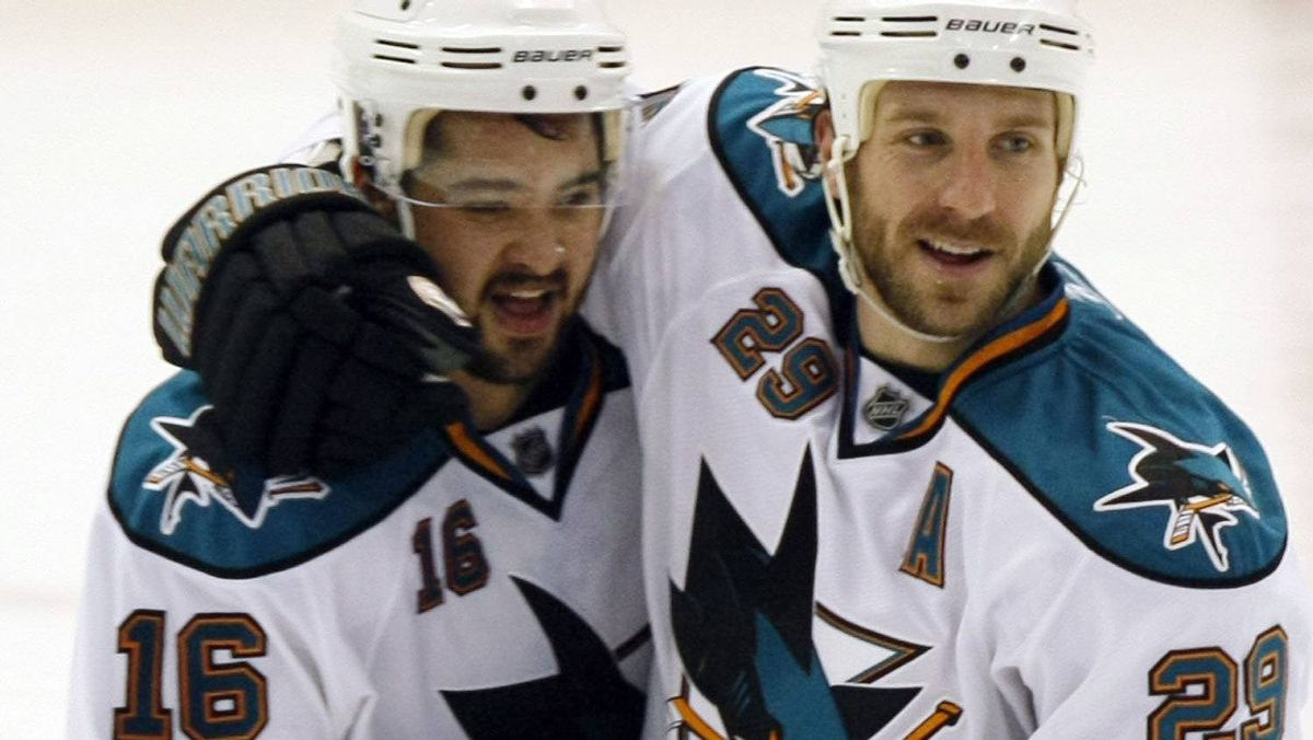San Jose Sharks right wing Devin Setoguchi (L) celebrates his game-winning goal with team-mate Ryane Clowe during overtime of Game 3 of the NHL Western Conference semi-finals hockey game against the Detroit Red Wings in Detroit, Michigan May 4, 2011. REUTERS/Rebecca Cook