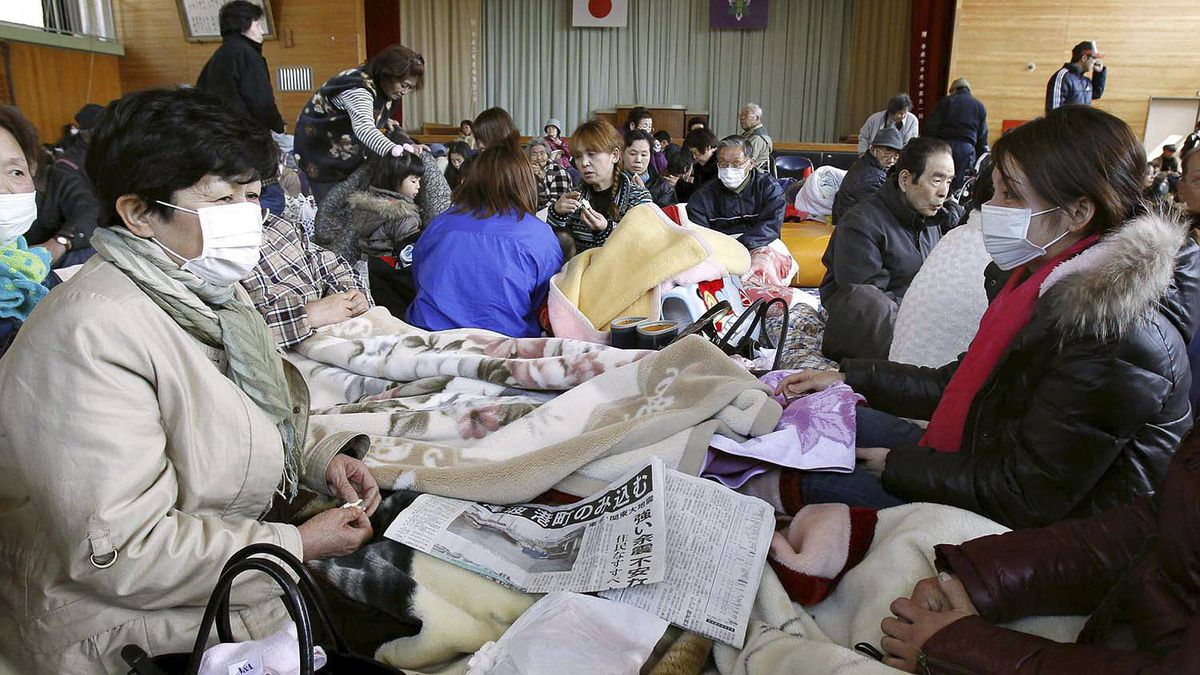 Residents take break at an evacuation center at Namie, not far from a nuclear power station in northeastern Japan, on Saturday March 12, 2011.