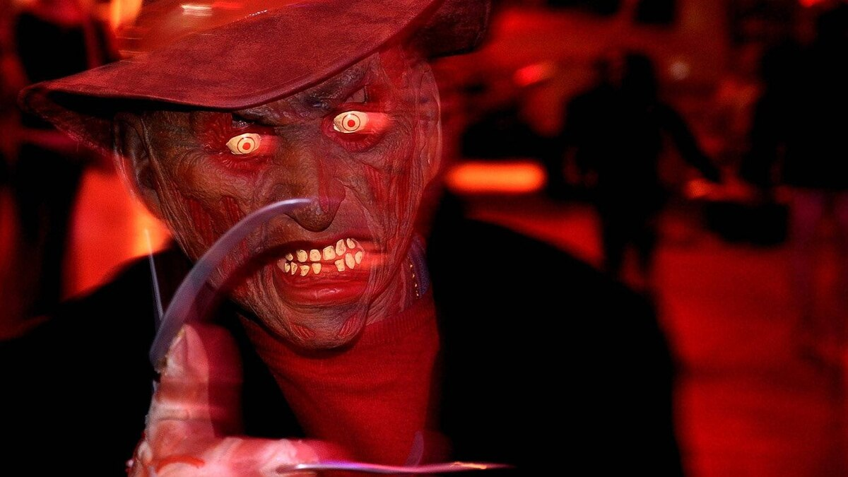 The six attractions include the Haunted House, the Field of Screams, the Darkness, the Asylum, the Diabolical House of Cards, and the Slasher Wax Museum, where you'll meet the Freddy pictured here.