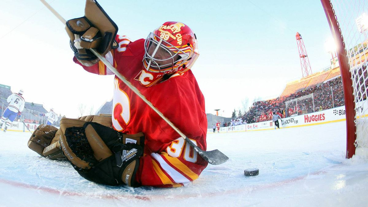 Mike Vernon #30 of the Calgary Flames Alumni allows a goal against the Montreal Canadiens Alumni during the game held as part of the 2011 NHL Heritage Classic festivities at McMahon Stadium on February 19, 2011 in Calgary, Alberta, Canada. (Photo by Andre Ringuette/Getty Images)