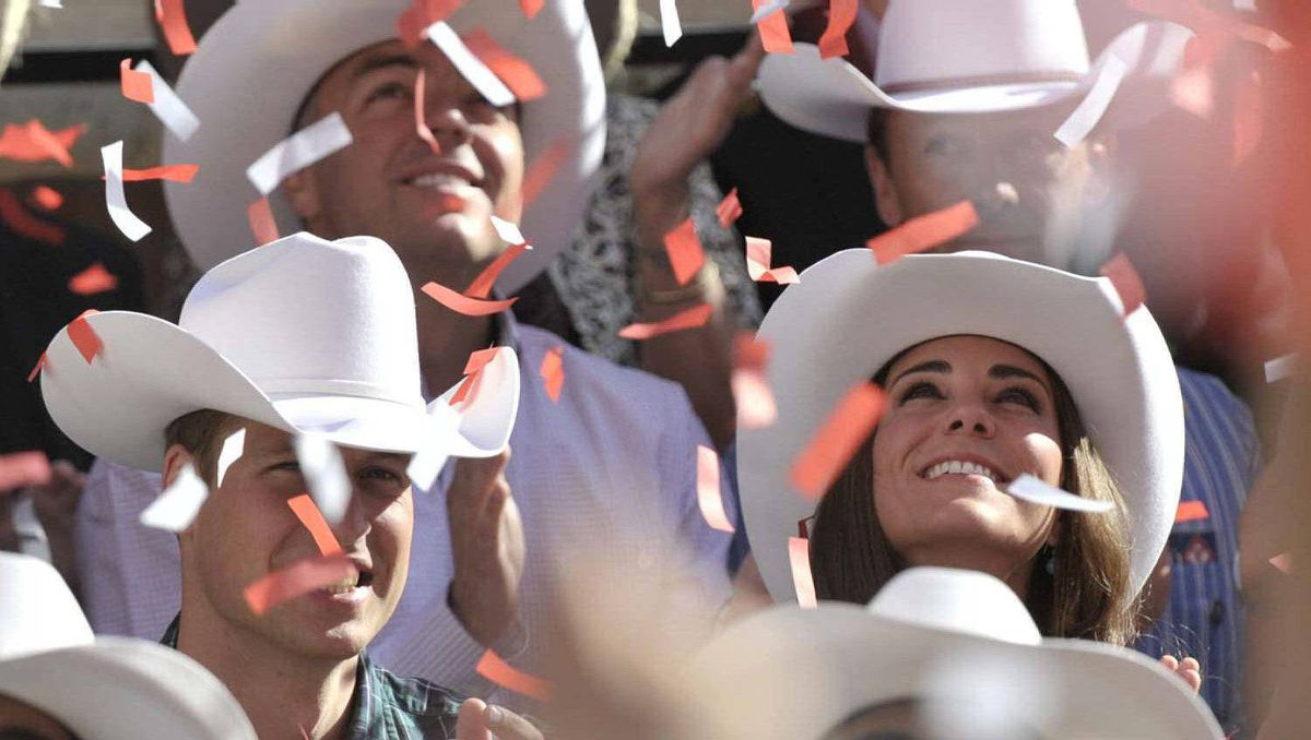 The Duke and Duchess of Cambridge watch the beginning of the Calgary Stampede parade in Calgary, Friday July 8, 2011.