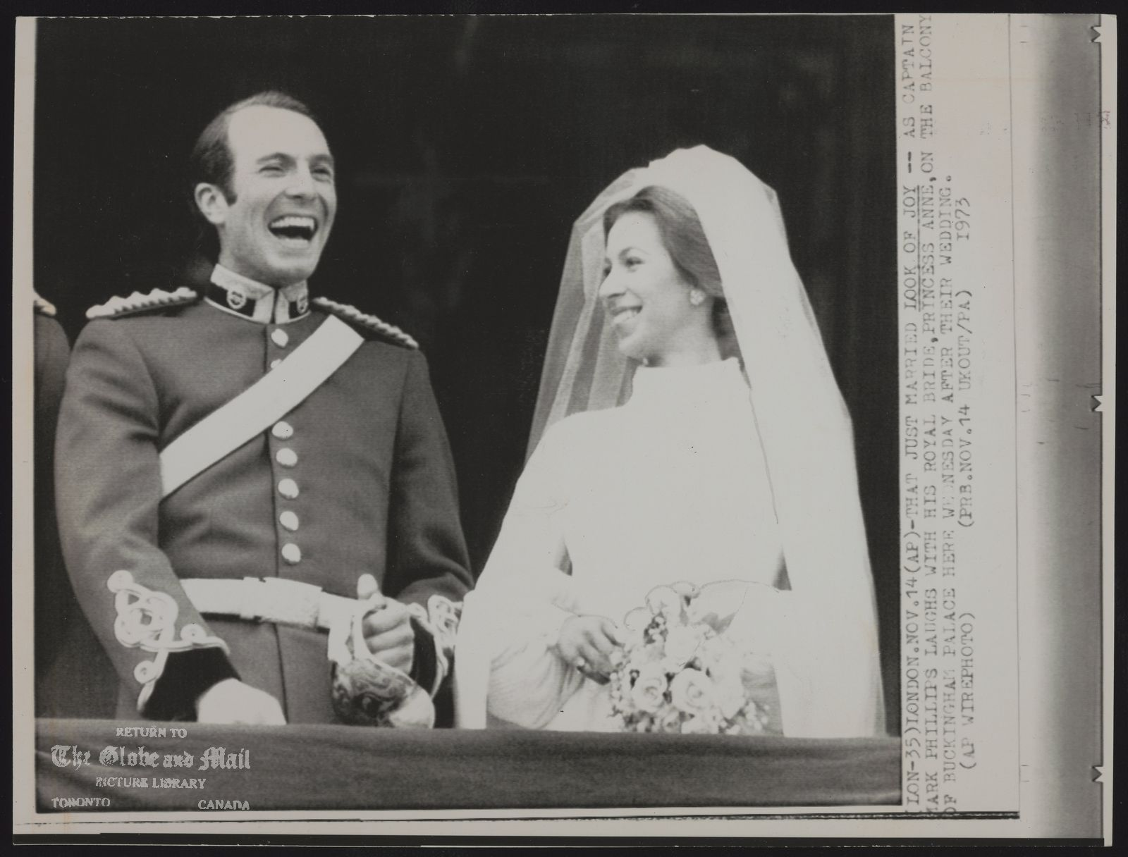 ROYAL FAMILY Gt. Britain Princess Anne (LON-35) LONDON. NOV. 14 (AP)-THAT JUST MARRIED LOOK OF JOY -- AS CAPTAIN MARK PHILLIPS LAUGHS WITH HIS ROYAL BRIDE, PRINCESS ANNE, ON THE BALCONY OF BUCKENGHAM PALACE HERE WEDNESDAY AFTER THEIR WEDDING.