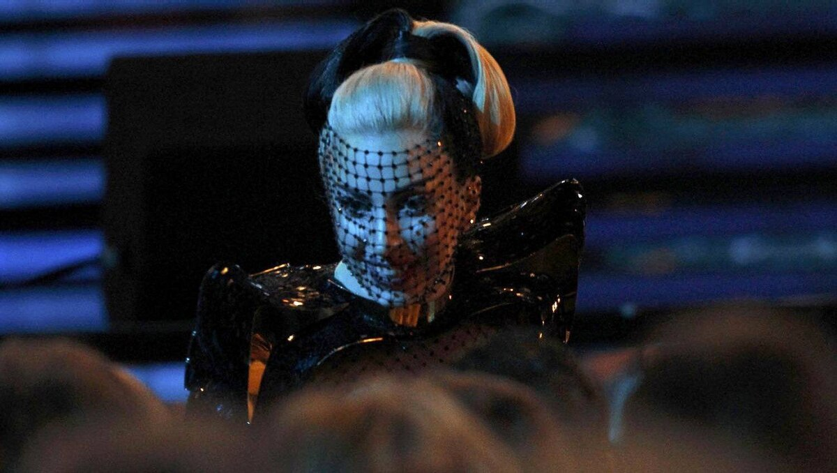 Lady Gaga takes her seat during a commercial break.