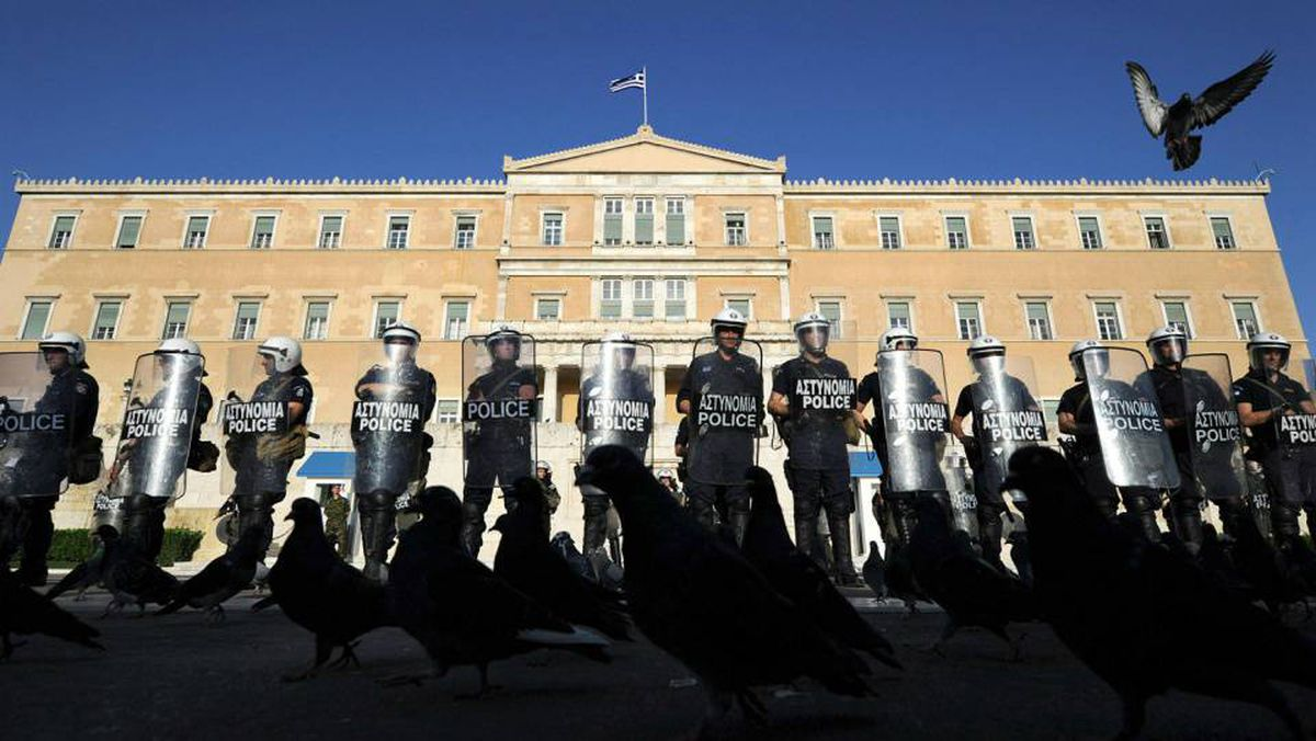 Riot policemen guard Greece's parliament during an anti-austerity demonstration on Thursday