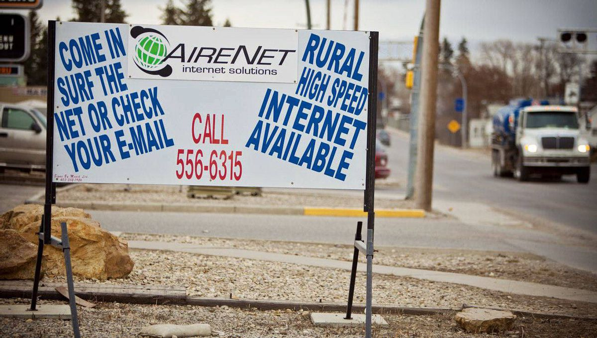 "A sign on the main street in downtown Olds, Alta., advertises ""rural high-speed"" Internet"