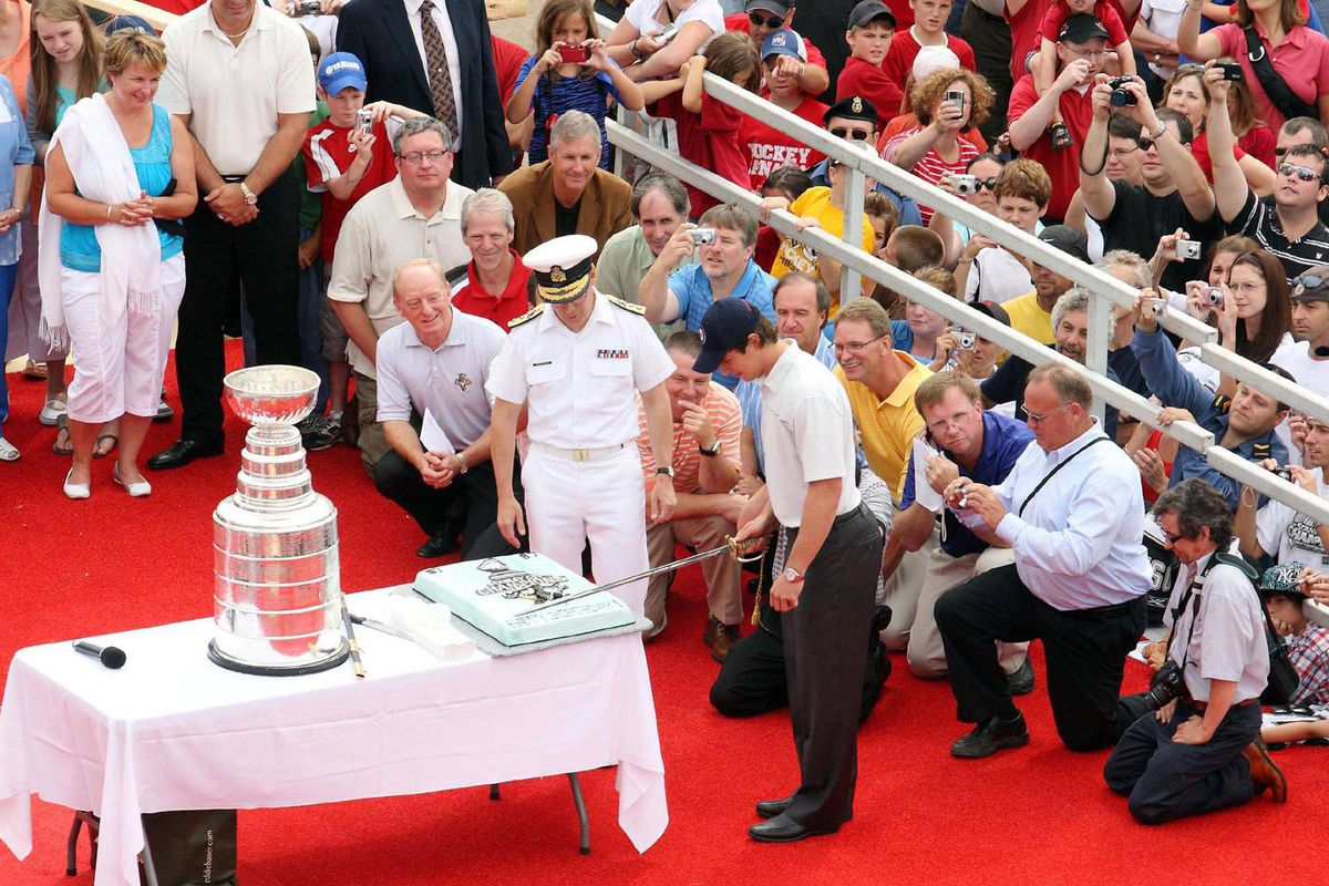 The pride of Nova Scotia was surprised by a birthday cake, which he cut with a sword while standing with Rear Admiral Paul Maddison on a naval jetty at CFB Halifax.