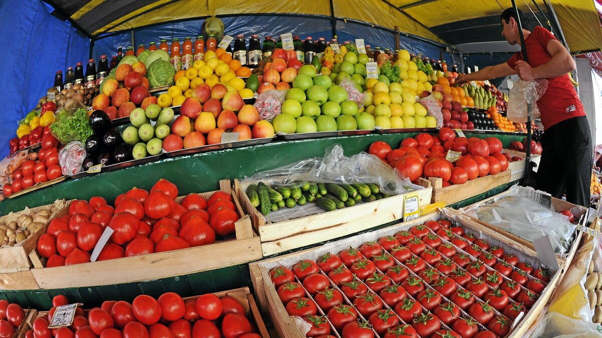 Fruits and vegetables, including tomatoes and cucumbers, are for sale at an outdoor mini market in Moscow, on June 2, 2011. Russia banned on June 2 the import of fresh vegetables from European Union countries because of a deadly bacteria scare, as Germany kept up the hunt for the source of the bug that has killed 18 people.