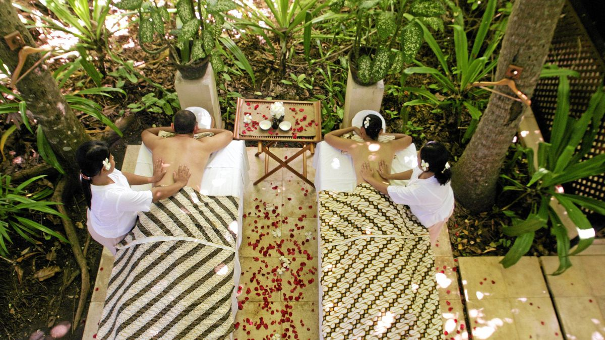 Massages at the coconut grove at the Amankila spa in Bali, Indonesia.