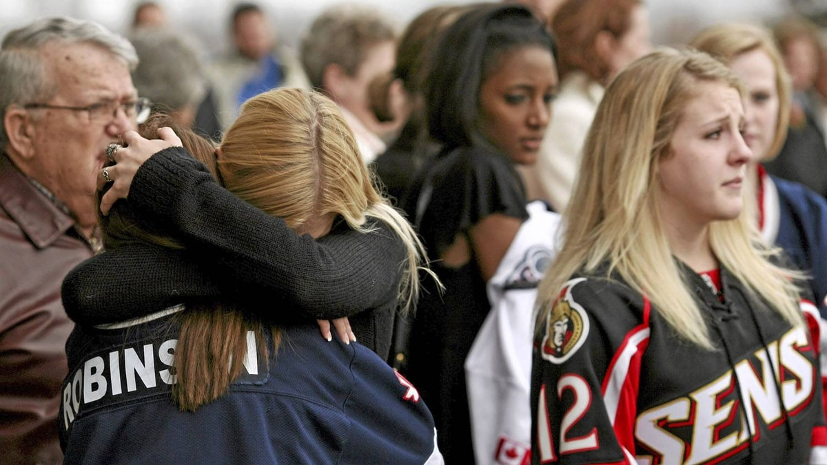 Mourners gather for Daron Richardson's memorial service at Scotiabank Place in Ottawa. Dave Chan for The Globe and Mail