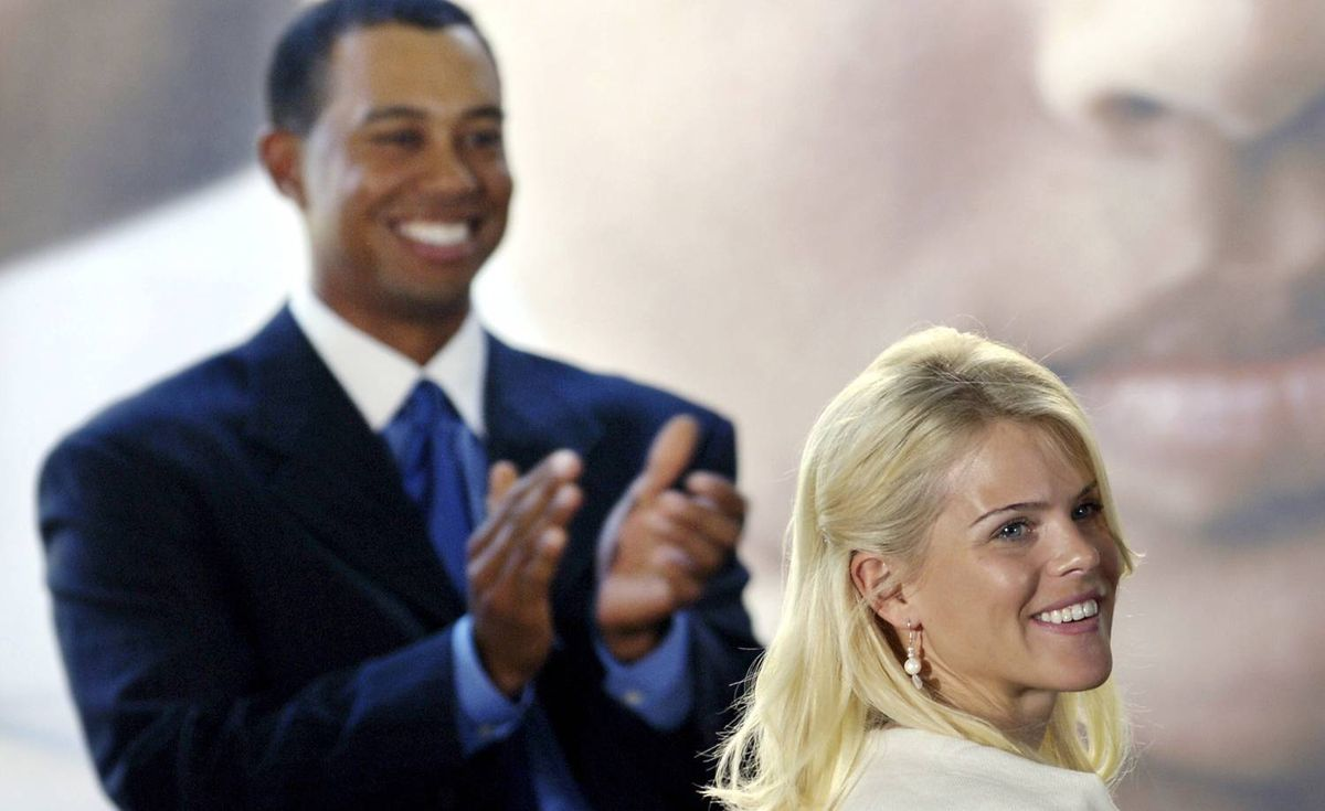 Elin Nordegren is introduced to the crowd as her husband Tiger Woods applauds during the dedication of the Tiger Woods Learning Center in Anaheim, California, on Feb. 10, 2006.