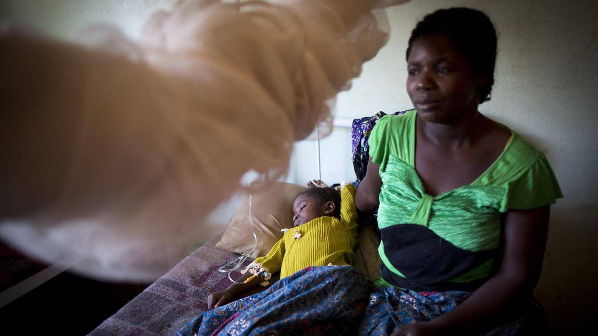 Jeanne Mbwisha sits with her daughter Seraphine Musomeka, recovering after a blood transfusion to treat severe malaria at a hospital in the city of Lubumbashi, in the Democratic Republic of the Congo.