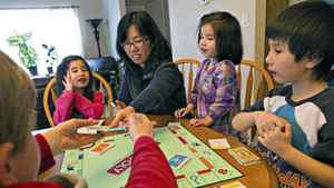 Clark Hunter, Sarah Kirsop, Marjorie Kirsop, Leah Kirsop and Paul Kirsop play Monopoly together in their home in Morinville after arriving home from school at Notre Dame Elementary on Wednesday March 2, 2011.