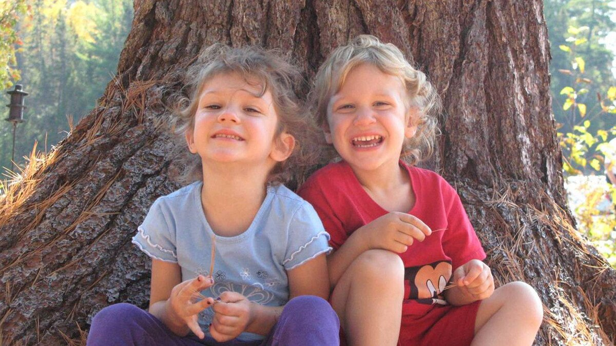 """Krista LaRiviere's daughter Chloe, and son Marco Zyp at the base of the giant tree the family calls """"the hugging tree."""""""