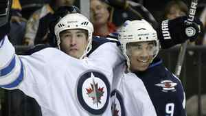 Winnipeg Jets right wing Spencer Machacek, left, celebrates with Evander Kane (9) after scoring against the Nashville Predators in the first period of a preseason NHL hockey game on Saturday, Sept. 24, 2011, in Nashville, Tenn. (AP Photo/Mark Humphrey)