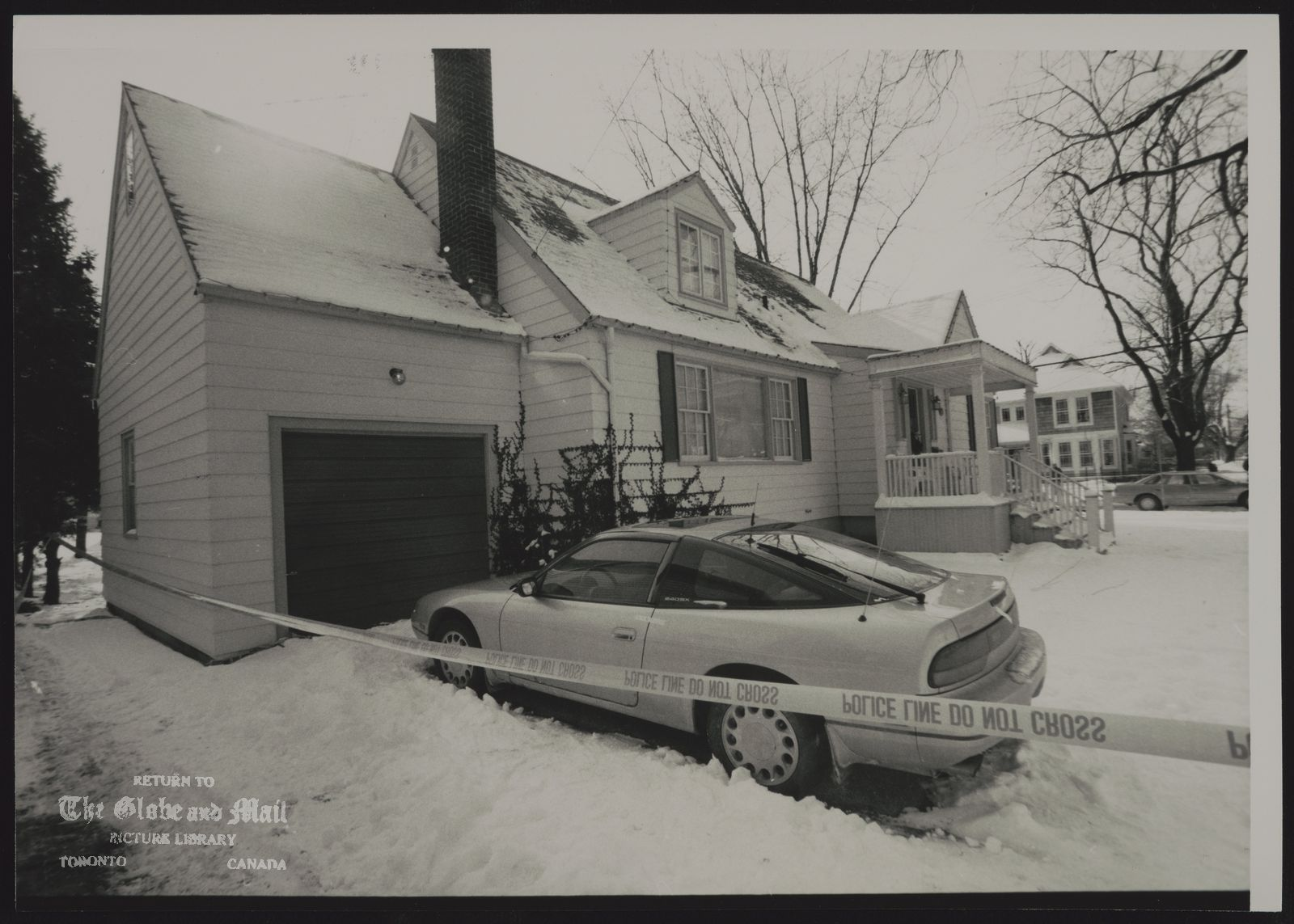 PAUL BERNARDO ST. CATHARINES. MURDER SUSPECT. PAUL BERNARDO'S CAR SITS IN DRIVEWAY BEHIND POLICE TAPE AT HIS HOME IN PORT DALHOUSIE.