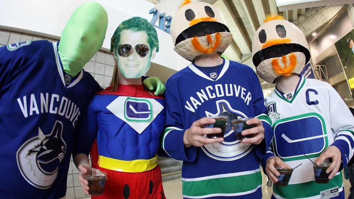 Fans of the Vancouver Canucks in costume show their support prior to Game Three. (Photo by Victor Decolongon/Getty Images)