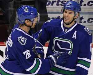 Vancouver Canucks' Ryan Kesler, right, and Mikael Samuelsson, of Sweden, celebrate Kesler's goal against the Edmonton Oilers during second period NHL action in Vancouver, B.C., on Saturday December 26, 2009. THE CANADIAN PRESS/Darryl Dyck