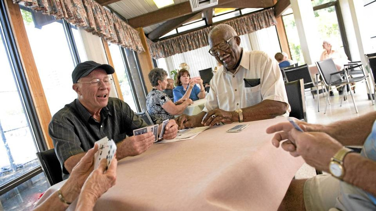 A group of seniors play bridge at the Stan Wadlow Clubhouse in the Cedarvale area of Toronto on July 27. The group meets regularly.