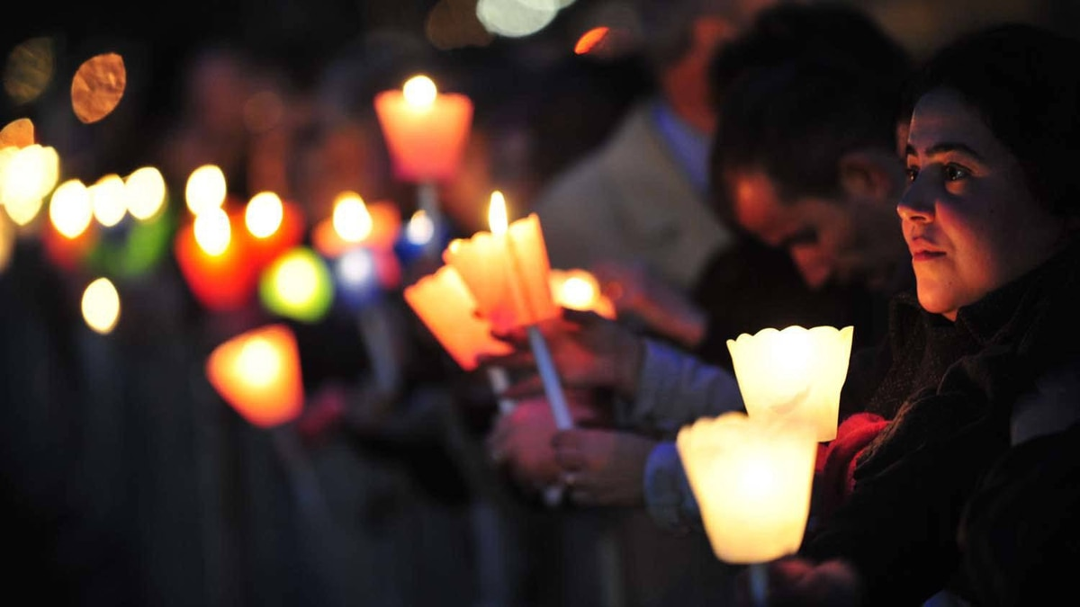 Pilgrims hold candles during a prayer vigil at the ancient Circus Maximus Arena in Rome on April 30, 2011, on the eve of the beatification of the late Pope John Paul II.