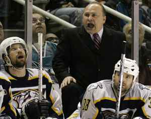Nashville Predators coach Barry Trotz, top center, instructs his team during the third period of the Predators' 3-2 loss to the San Jose Sharks in Game 4 of a first-round NHL hockey playoff series in San Jose, Calif., Wednesday, April 18, 2007. San Jose leads the series 3-1. (AP Photo/Marcio Jose Sanchez)