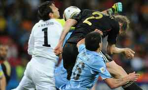 Germany's midfielder Marcell Jansen (2) heads the ball past Uruguay's goalkeeper Fernando Muslera (1) and defender Maximiliano Pereira to score his team's second goal during the 2010 World Cup third place football match between Uruguay and Germany on July 10, 2010 at Nelson Mandela Bay Stadium in Port Elizabeth, South Africa. Getty Images / FRANCK FIFE