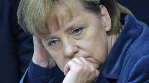 German Chancellor Angela Merkel listens to a speech at the German federal parliament, Bundestag, in Berlin, Germany, Wednesday, Oct. 26, 2011.
