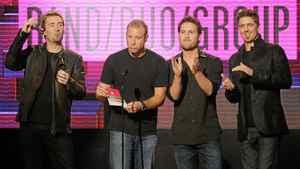 Chad Kroeger, Mike Kroeger, Ryan Peake and Daniel Adair of Nickelback present an award at the 2011 American Music Awards in Los Angeles on Sunday, Nov. 20, 2011.