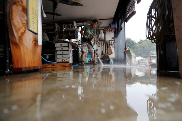 Typhoon victims in Japan believed the worst was over – then the floods came