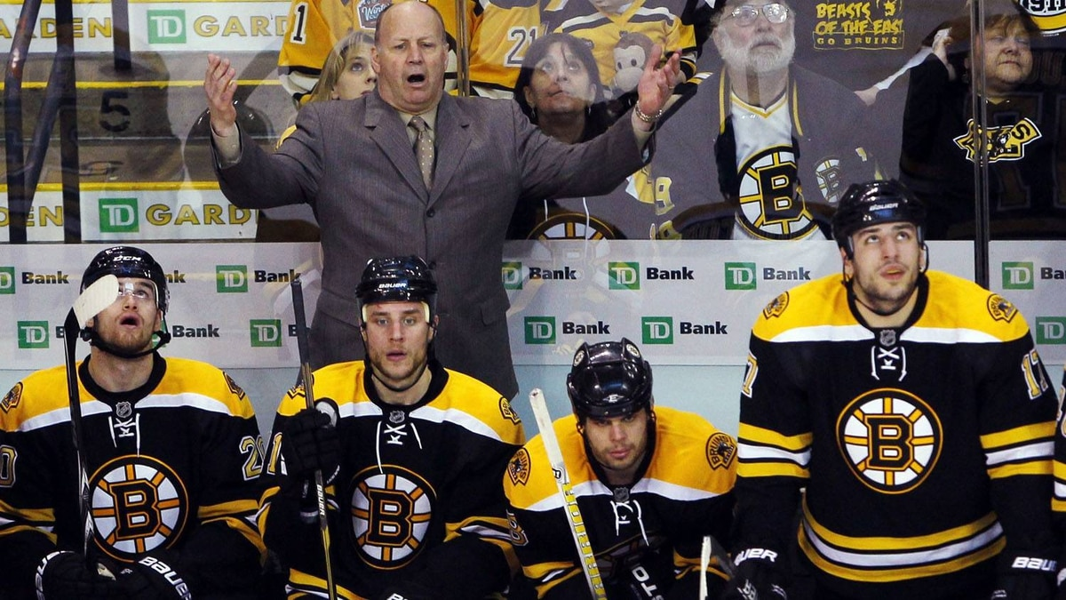 Boston Bruins head coach Claude Julien reacts to a penalty call against the Bruins during the first period. REUTERS/Brian Snyder