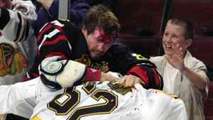 In this Oct. 28, 2001, file photo, Chicago Blackhawks' Bob Probert, left, and Boston Bruins' Andrei Nazarov mix it up along the boards during a first period fight in Chicago. Enforcers, goons, whatever you want to call them, players like Bob Probert and Derek Boogaard made careers from dishing out and taking punishing hits. That job is sure to come under added scrutiny after thesudden death of Boogaard, five months after he suffered a season-ending concussion.