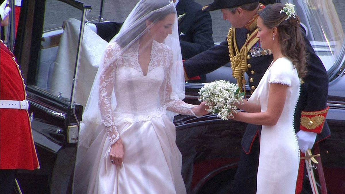 In this image taken from video, Kate Middleton, left, receives flowers from her sister, Pippa Middleton as she arrives at Westminster Abbey for the Royal Wedding in London on Friday, April, 29, 2011.