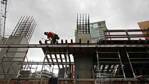 Workers construct a condo development in downtown Vancouver in this file photo.